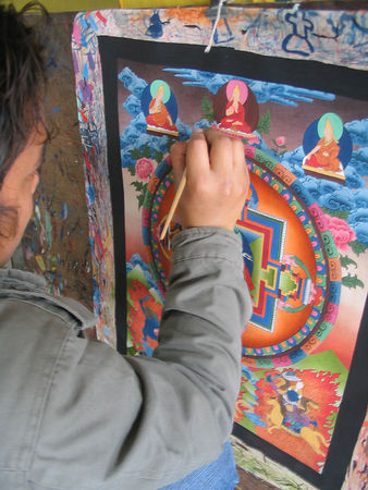 artisan creating thanka
